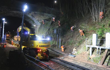 Abseiling rail workers help keep trains moving in fight against Covid-19.