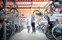Will Norman, London's walking and cycling commissioner and Clyde Noakes at a cycle parking hub in Walthamstow.